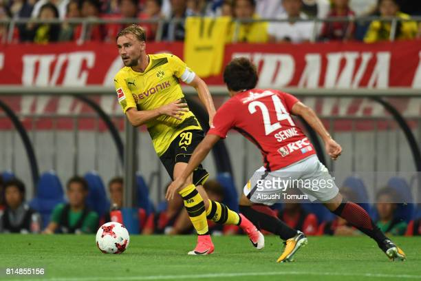 Marcel Schmelzer of Borussia Dortmund runs with the ball during the preseason friendly match between Urawa Red Diamonds and Borussia Dortmund at...