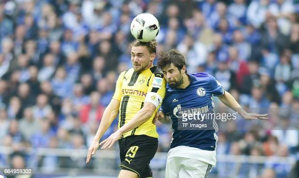 Marcel Schmelzer of Dortmund and Coke of Schalke battle for the ball during the Bundesliga match between FC Schalke 04 and Borussia Dortmund at...