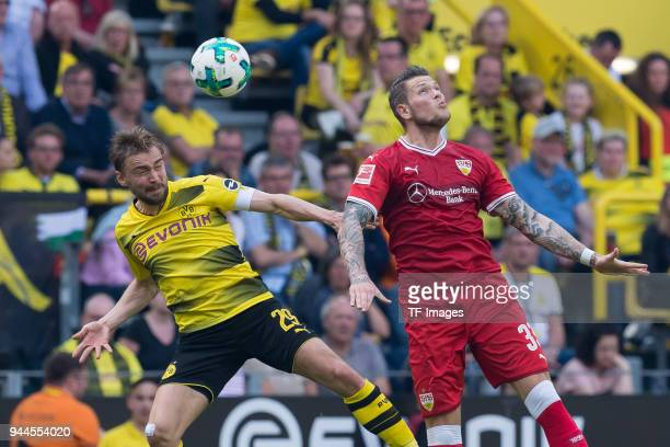 Marcel Schmelzer of Dortmund and Daniel Ginczek of Stuttgart battle for the ball during the Bundesliga match between Borussia Dortmund and VfB...