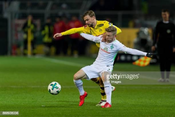 Marcel Schmelzer of Dortmund and Florian Kainz of Bremen battle for the ball during the Bundesliga match between Borussia Dortmund and SV Werder...