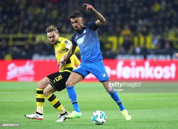 Marcel Schmelzer of Dortmund and Kerem Demirbay of Hoffenheim battle for the ball during the Bundesliga match between Borussia Dortmund and TSG 1899...