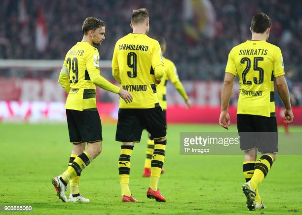 Marcel Schmelzer of Dortmund Andrey Yarmolenko of Dortmund and Sokratis Papastathopoulos of Dortmund look dejected after the DFB Cup match between...
