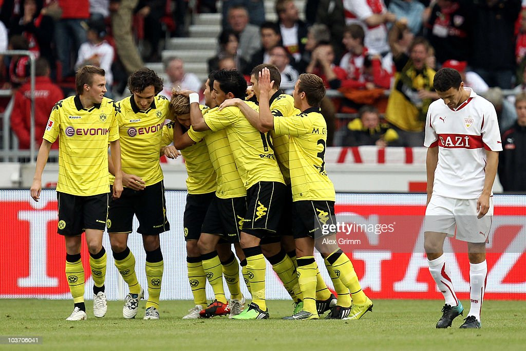 Marcel Schmelzer (C) of Dortmund celebrates his team's first goal with team mates as Khalid Boulahrouz (R) of Stuttgart reacts during the Bundesliga match between VfB Stuttgart and Borussia Dortmund at the Mercedes-Benz Arena on August 29, 2010 in Stuttgart, Germany.