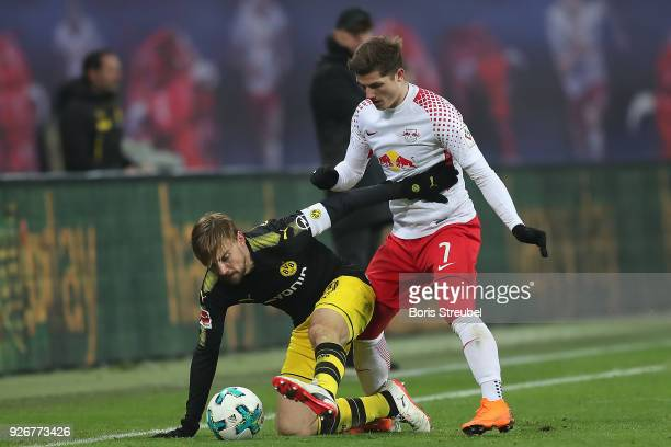 Marcel Schmelzer of Dortmund fights for the ball with Marcel Sabitzer of Leipzig during the Bundesliga match between RB Leipzig and Borussia Dortmund...