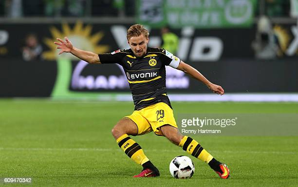 Marcel Schmelzer of Dortmund kicks the ball during the Bundesliga match between VfL Wolfsburg and Borussia Dortmund at Volkswagen Arena on September...