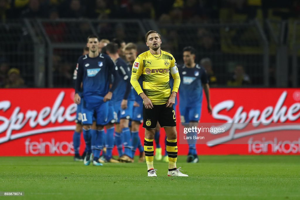 Marcel Schmelzer of Dortmund looks dejected after Hoffenheim scored a goal to make it 0:1 during the Bundesliga match between Borussia Dortmund and TSG 1899 Hoffenheim at Signal Iduna Park on December 16, 2017 in Dortmund, Germany.