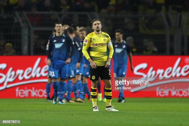 Marcel Schmelzer of Dortmund looks dejected after Hoffenheim scored a goal to make it 01 during the Bundesliga match between Borussia Dortmund and...