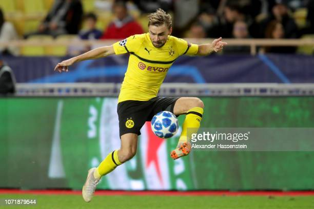 Marcel Schmelzer of Dortmund runs with the ball during the UEFA Champions League Group A match between AS Monaco and Borussia Dortmund at Stade Louis...