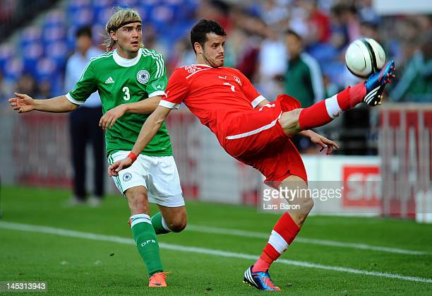 Marcel Schmelzer of Germany challenges Tranquillo Barnetta of Switzerland during the international friendly match between Switzerland and Germany at...