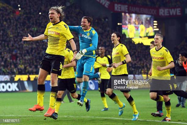 Marcel Schmelzer Roman Weidenfeller Neven Subotic and Sven Bender of Dortmund celebrate winning 20 and the german Championships after the 1...