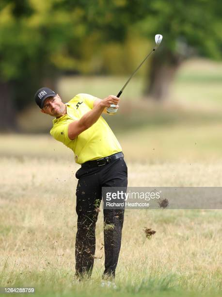 Marcel Schneider of Germany plays his approach shot on the 17th hole during Day One of the English Championship at Hanbury Manor Marriott Hotel &...