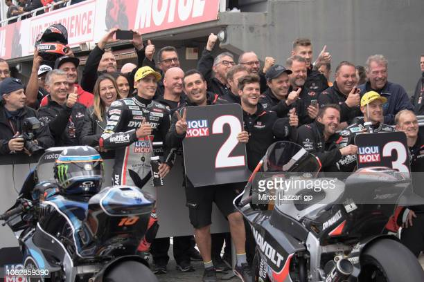Marcel Schrotter of Germany and Dynavolt Intact GP and Xavi Vierge of Spain and Dynavolt Intact GP celebrate with team at the end of the qualifying...