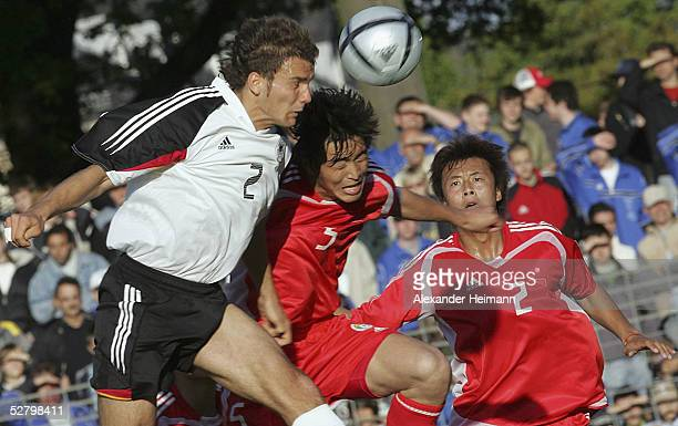 Marcel Schuon of Germany and Feng Xiaoting of China go up for the ball during the match between Germany and China in the men's under 20's...
