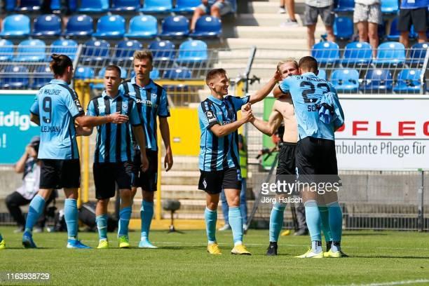 Marcel Seegert of Waldhof Mannheim celebrate his goal with Michael Schultz of Waldhof Mannheim and Florian Flick of Waldhof Mannheim during the 3....