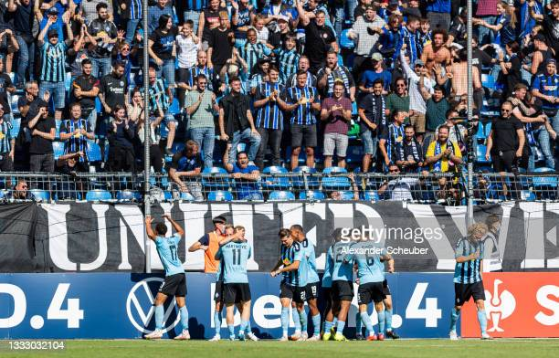 Marcel Seegert of Waldhof Mannheim celebrates the first goal for his team with his teammates during the DFB Cup first round match between Waldhof...
