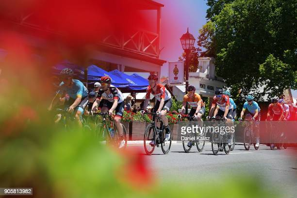 Marcel Sieberg of Germany and Lotto Soudal and Andre Greipel of Germany and Lotto Soudal compete past the German Arms in Hahndorf during stage two of...