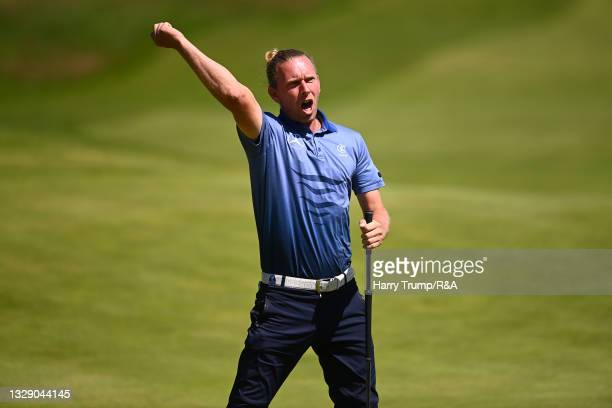 Marcel Siem of Germany celebrates a putt on the 18th hole during Day Two of The 149th Open at Royal St George's Golf Club on July 16, 2021 in...
