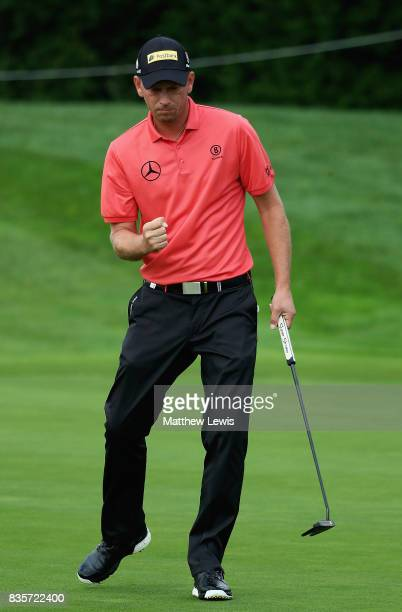 Marcel Siem of Germany celebrates aputt on the 2nd green during the Semi final match on day four of the Saltire Energy Paul Lawrie Matchplay at Golf...
