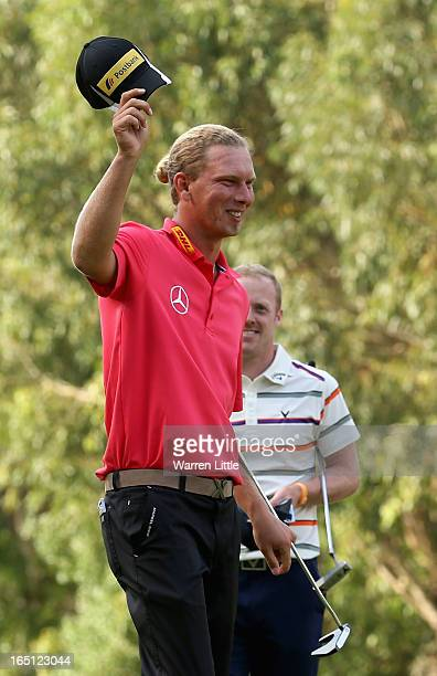 Marcel Siem of Germany celebrates winning the Trophee du Hassan II Golf on a score of -17 under par at Golf du Palais Royal on March 31, 2013 in...