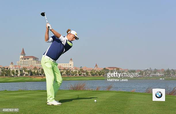 Marcel Siem of Germany hits his tee-shot on the ninth hole during day four of the BMW Masters at Lake Malaren Golf Club on November 2, 2014 in...