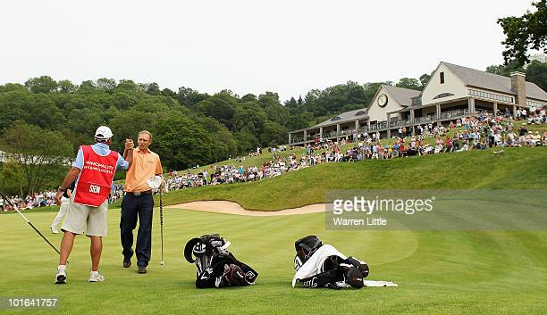Marcel Siem of Germany is congratulated by his caddie Kyle Roadley on the 18th green during the third round of the Celtic Manor Wales Open on The...