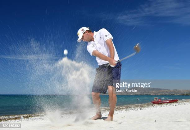 Marcel Siem of Germany plays a shot on the beach prior to the start of The Rocco Forte Open at Verdura Golf and Spa Resort on May 16 2017 in Sciacca...