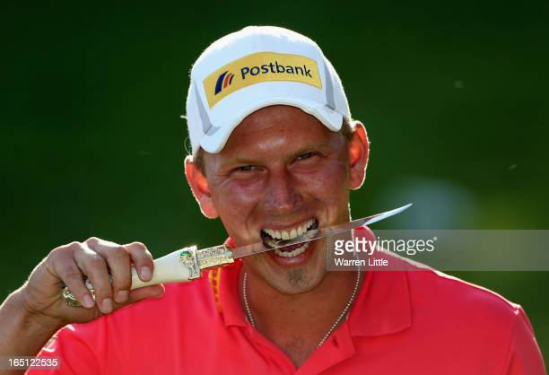 Marcel Siem of Germany poses with the trophy dagger after winning the Trophee du Hassan II Golf on a score of 17 under par at Golf du Palais Royal on...