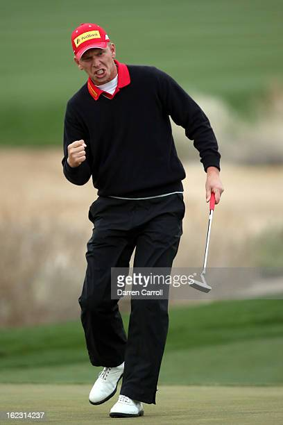 Marcel Siem of Germany reacts after he made a birdie putt on the 17th hole green during the first round of the World Golf Championships - Accenture...