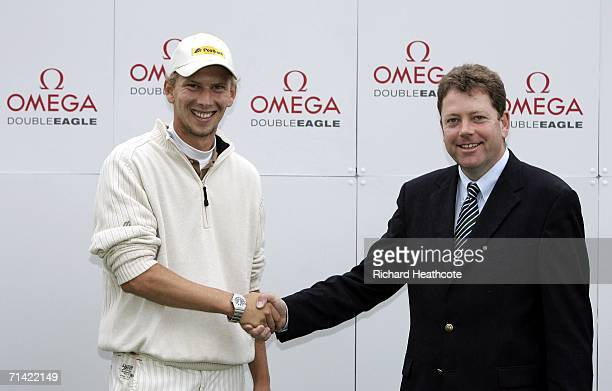 Marcel Siem of Germany receives an Omega Double Eagle watch from Tournament Director Peter Adams during the proam for The Barclays Scottish Open at...
