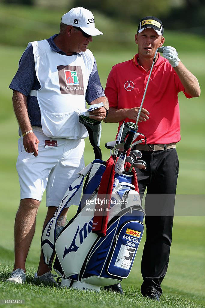 Marcel Siem of Germany selects a club during the final round of the Trophee du Hassan II Golf at Golf du Palais Royal on March 31, 2013 in Agadir, Morocco.
