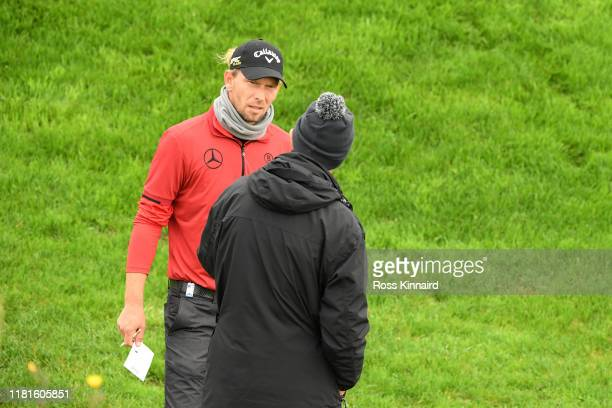 Marcel Siem of Germany speaks to a referee during day one of the Open de France at Le Golf National on October 17, 2019 in Paris, France.