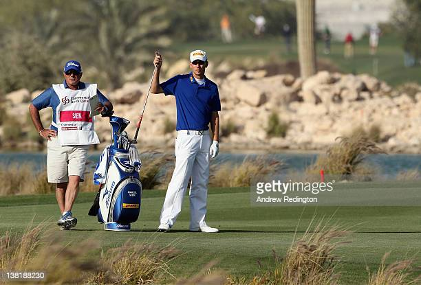 Marcel Siem of Germany stands with his caddie Kyle Roadley during the second round of the Commercialbank Qatar Masters held at Doha Golf Club on...