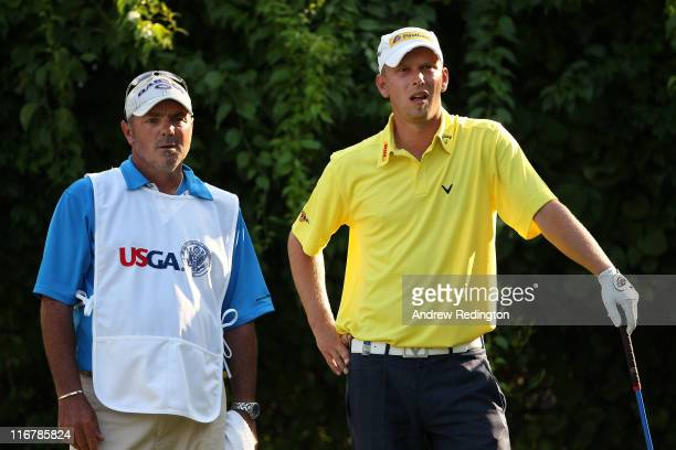 Marcel Siem of Germany talks with his caddie Kyle Roadley on the 18th tee during the second round of the 111th US Open at Congressional Country Club...