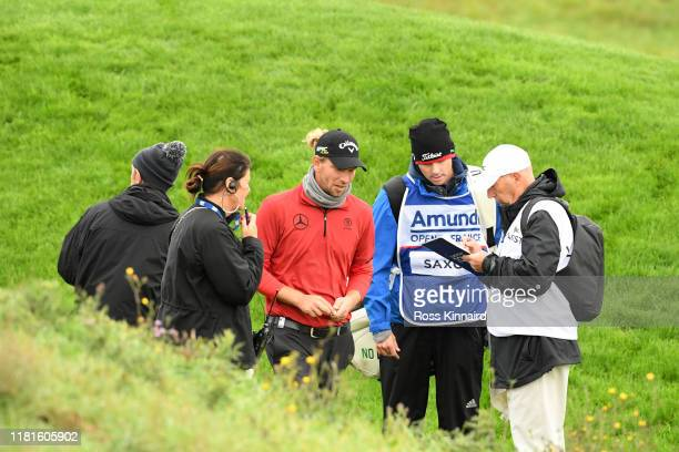 Marcel Siem of Germany walks off the course after being disqualified during day one of the Open de France at Le Golf National on October 17, 2019 in...