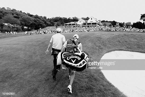 Marcel Siem of Germany walks up to the 18th green with his caddie Kyle Roadley during the third round of the Celtic Manor Wales Open on The Twenty...