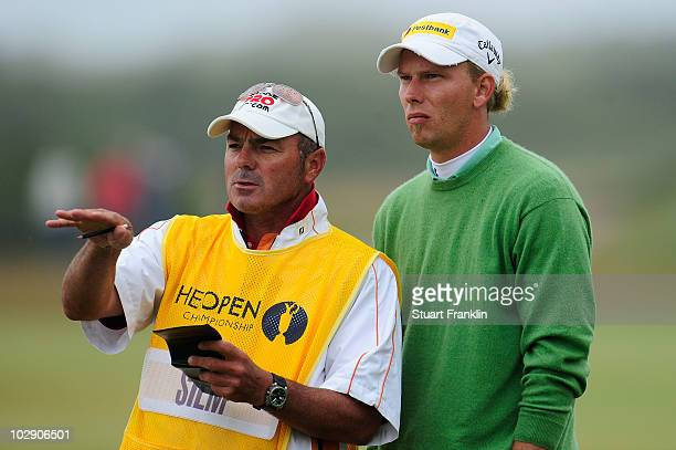 Marcel Siem of Germany with his caddy Kyle Roadley on the 11th hole during the first round of the 139th Open Championship on the Old Course St...