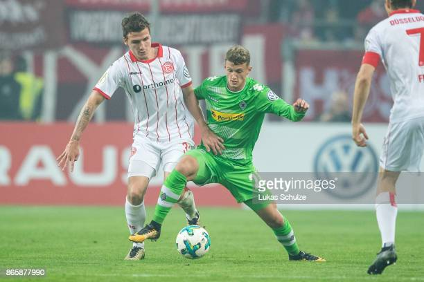 Marcel Sobottka of Duesseldorf and Mickael Cuisance of Moenchengladbach fight for the ball during the DFB Cup match between Fortuna Duesseldorf and...