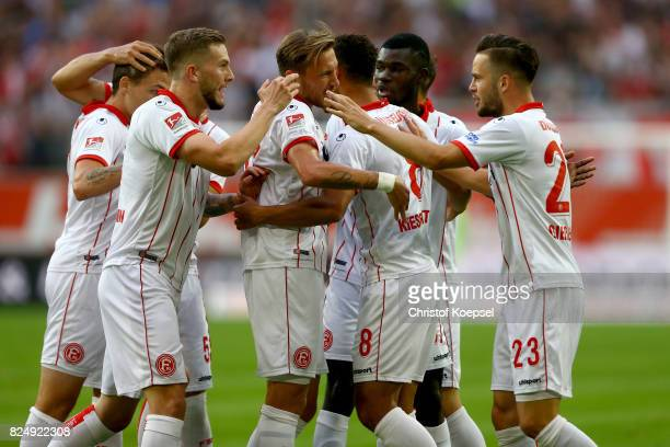Marcel Sobottka of Duesseldorf celebrates the first goal with his team mates during the Second Bundesliga match between Fortuna Duesseldorf and...