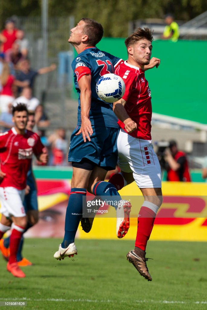 Marcel Sobottka of Fortuna Duesseldorf and Christian Meinert of RW Koblenz battle for the ball during the DFB Cup first round match between TuS RW Koblenz and Fortuna Duesseldorf at Stadion Oberwerth on August 19, 2018 in Koblenz am Rhein, Germany.