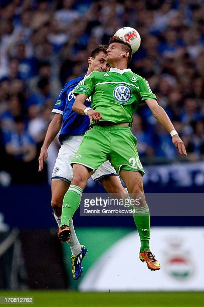 Marcel Sobottka of Schalke and Tugay Uzan of Wolfsburg go for a header during the A Juniors Championships semifinal second leg match between Schalke...