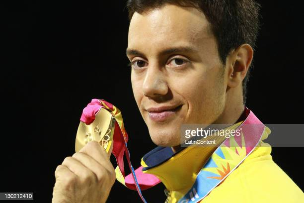 Marcel Sturmer of Brazil shows gold medal in the men's free program during the 2011 XVI Pan American Games at Pan American Roller Skating Track on...