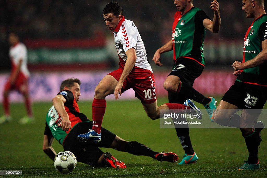 Marcel Stutter (#27), Rens Van Eijden (#3) and Nick Van der Velden (#23) of NEC are beaten by Tommy Oar (#10) of Utrecht during the Eredivisie match between NEC Nijmegen and FC Utrecht at the McDOS Goffertstadion on November 24, 2012 in Nijmegen, Netherlands.