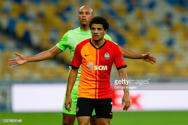 Marcel Tisserand of VfL Wolfsburg and Taison of Shakhtar Donetsk look on during the UEFA Europa League round of 16 second leg match between Shakhtar...