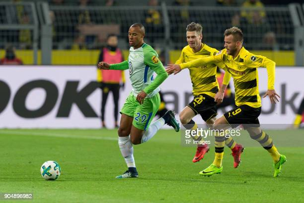 Marcel Tisserand of Wolfsburg and Andrey Yarmolenko of Dortmund battle for the ball during the Bundesliga match between Borussia Dortmund and VfL...