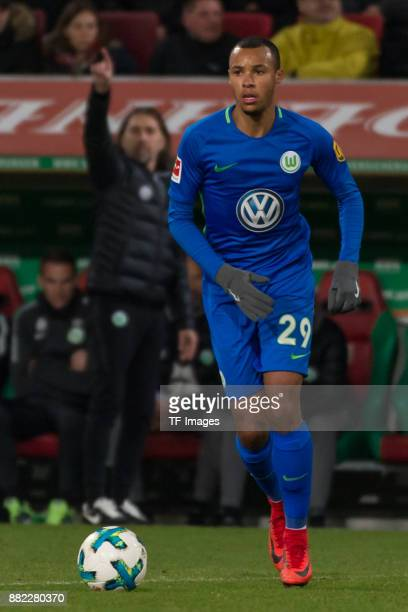 Marcel Tisserand of Wolfsburg controls the ball during the Bundesliga match between FC Augsburg and VfL Wolfsburg at WWKArena on November 25 2017 in...