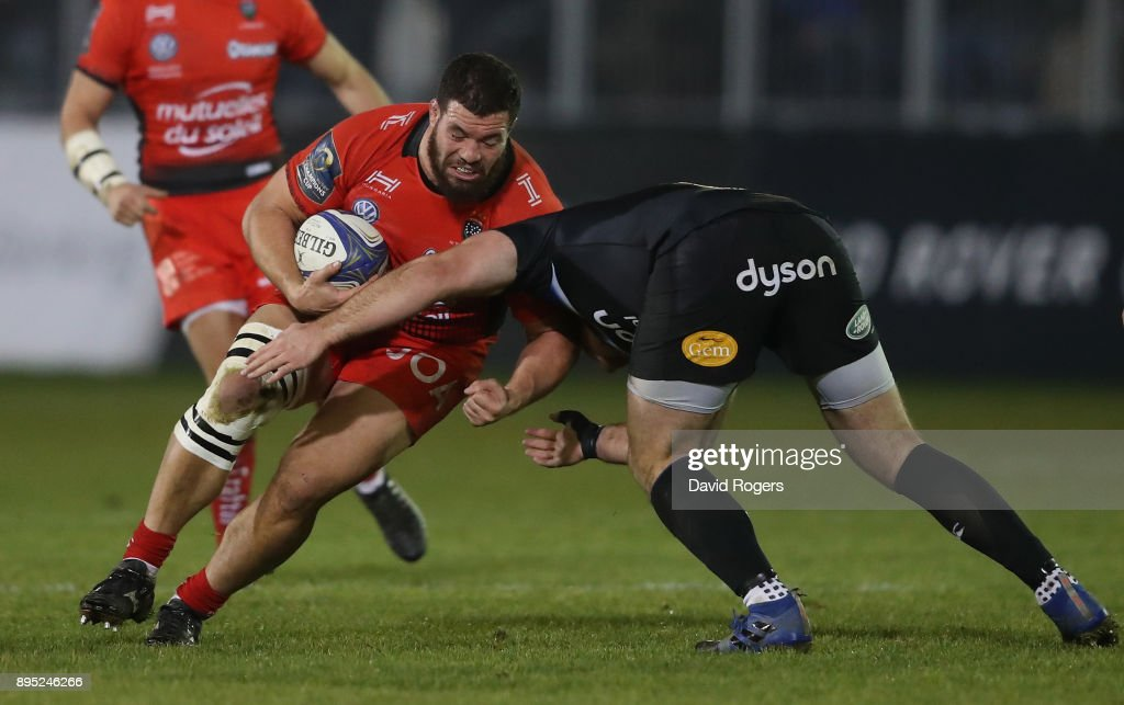 Marcel van der Merwe of Toulon is tackled during the European Rugby Champions Cup match between Bath Rugby and RC Toulon at the Recreation Ground on December 16, 2017 in Bath, England.