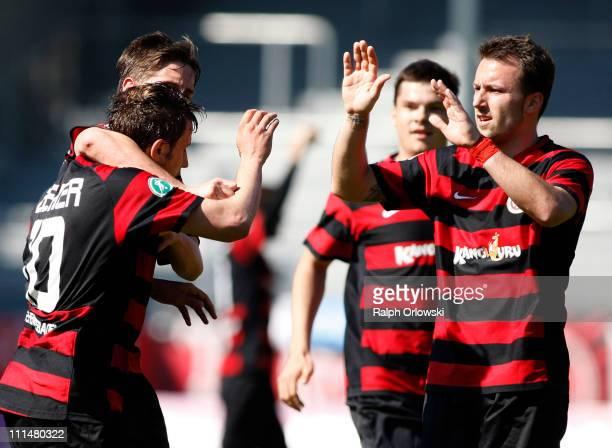 Marcel Ziemer and Zlatko Janjic of Wehen celebrate Ziemers' goal against Bayern Muenchen during the Third League match between SV Wehen Wiesbaden and...