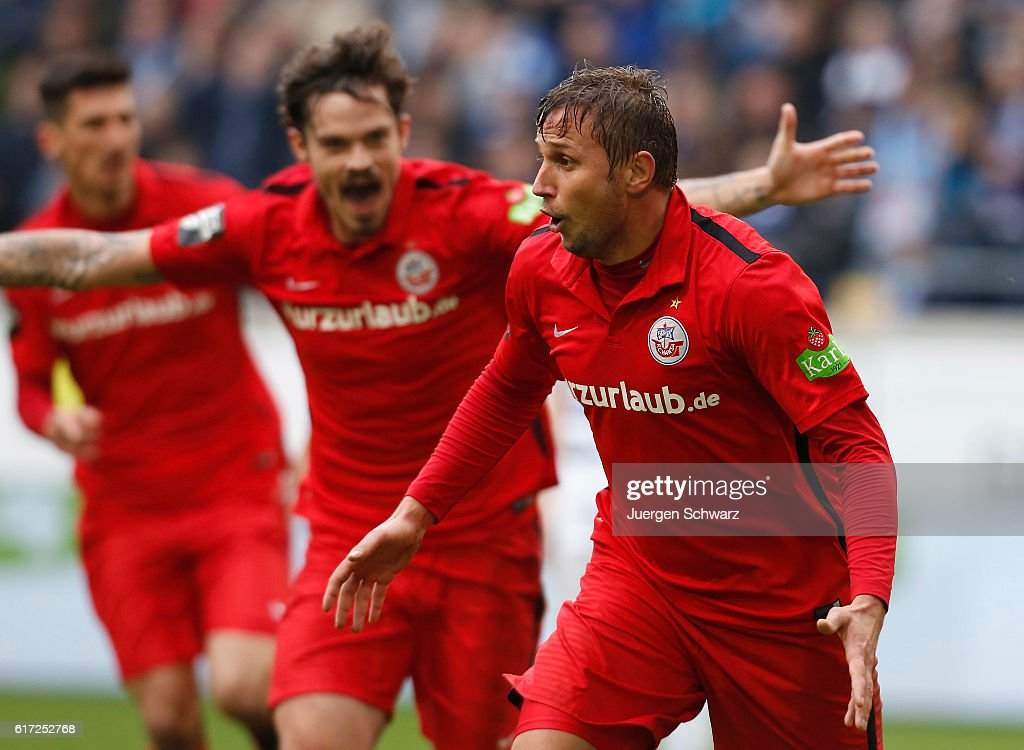 Marcel Ziemer of Rostock (R) celebrates after scoring during the third league match between MSV Duisburg and Hansa Rostock at Schauinsland-Reisen-Arena on October 22, 2016 in Duisburg, Germany.