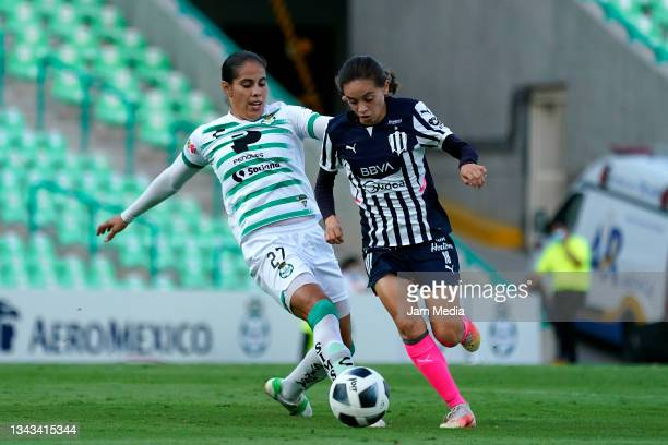 Marcela Valera of Santos fights for the ball with Aylin Aviles of Monterrey during a match between Santos and Monterrey as part of the Torneo Grita...