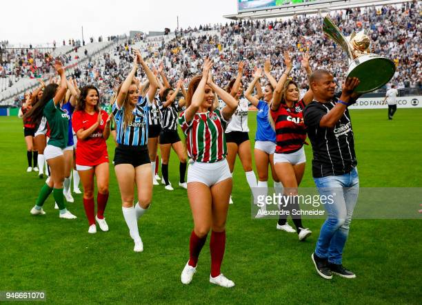 Marcelinho Carioca former football player holds the Brasileirao 2018 trophy before the match between Corinthinas and Fluminense for the Brasileirao...